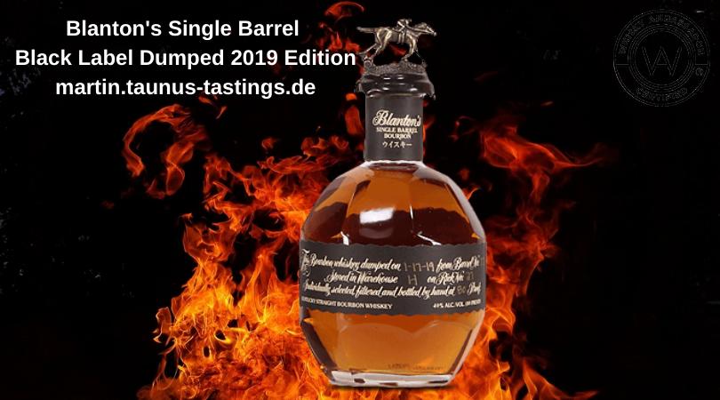 Eine Flasche Blanton's Single Barrel Black Label Dumped 2019 Edition, im Hintergrund Feuer